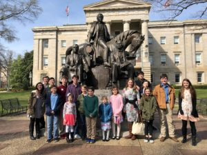 Forsyth County 4-H Trailblazers Teen 4-H Club in front of horse and rider statue