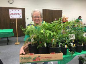 Extension Master Gardener Volunteer with plants
