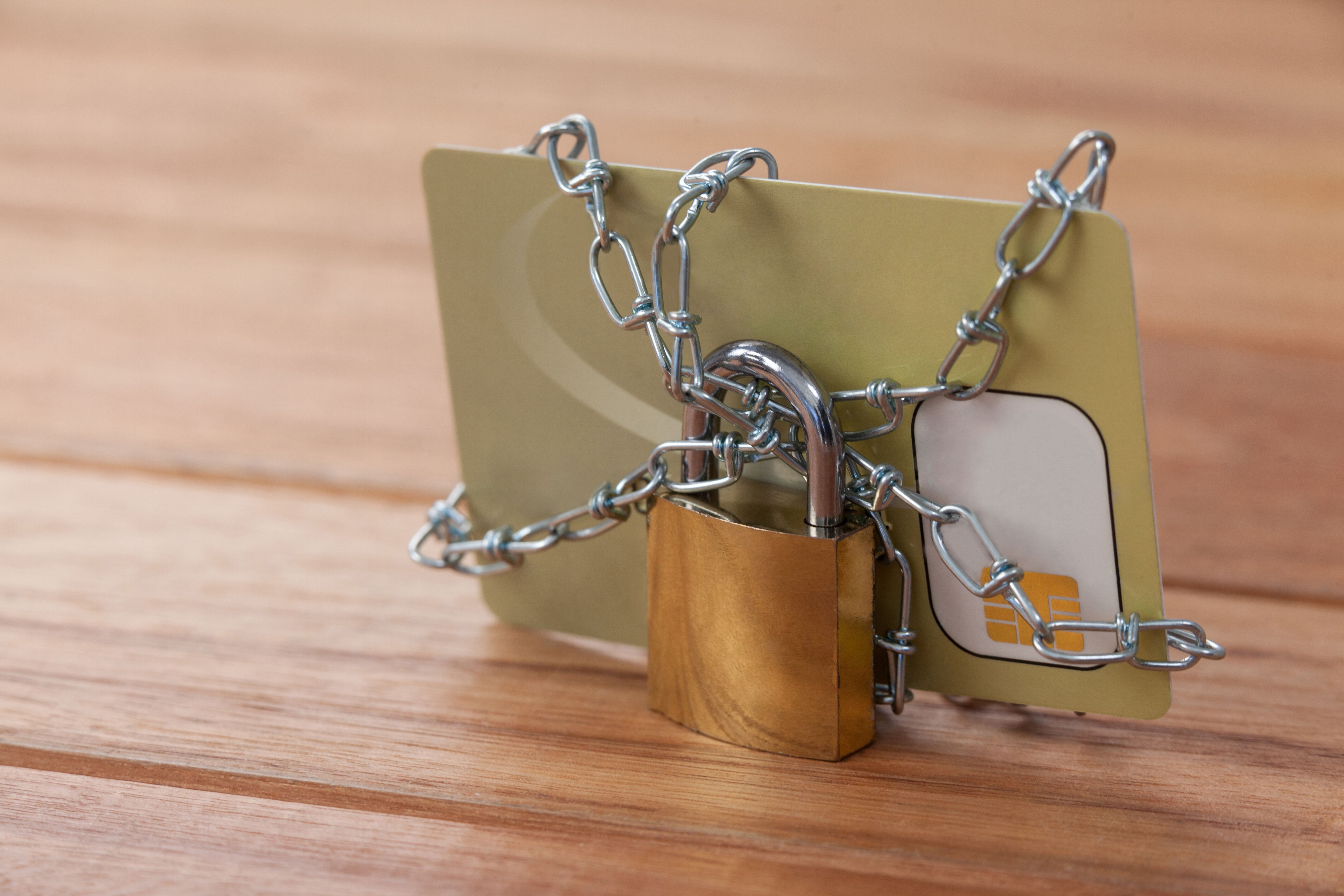 Lock and chain on credit card