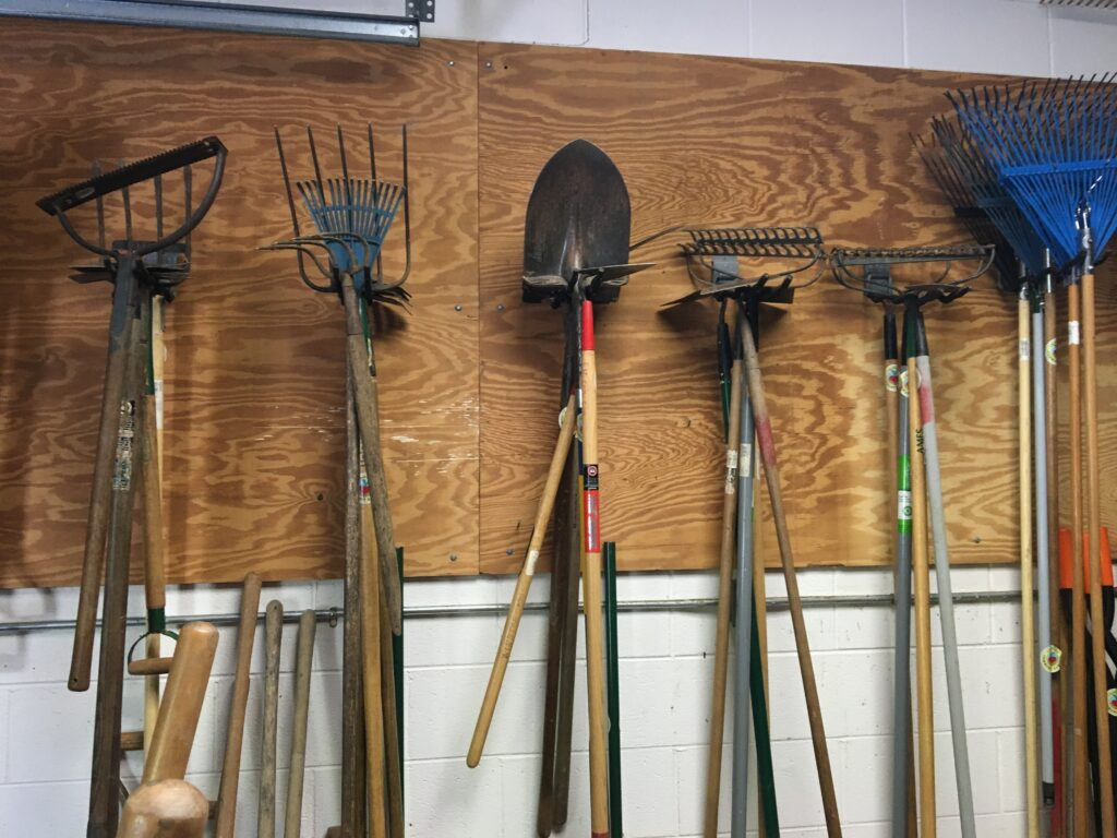 Garden tools hanging in garage