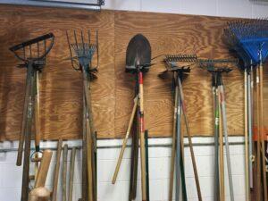 Garden tools hanging in garage