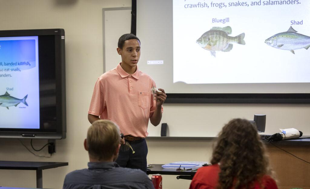 boy giving presentation