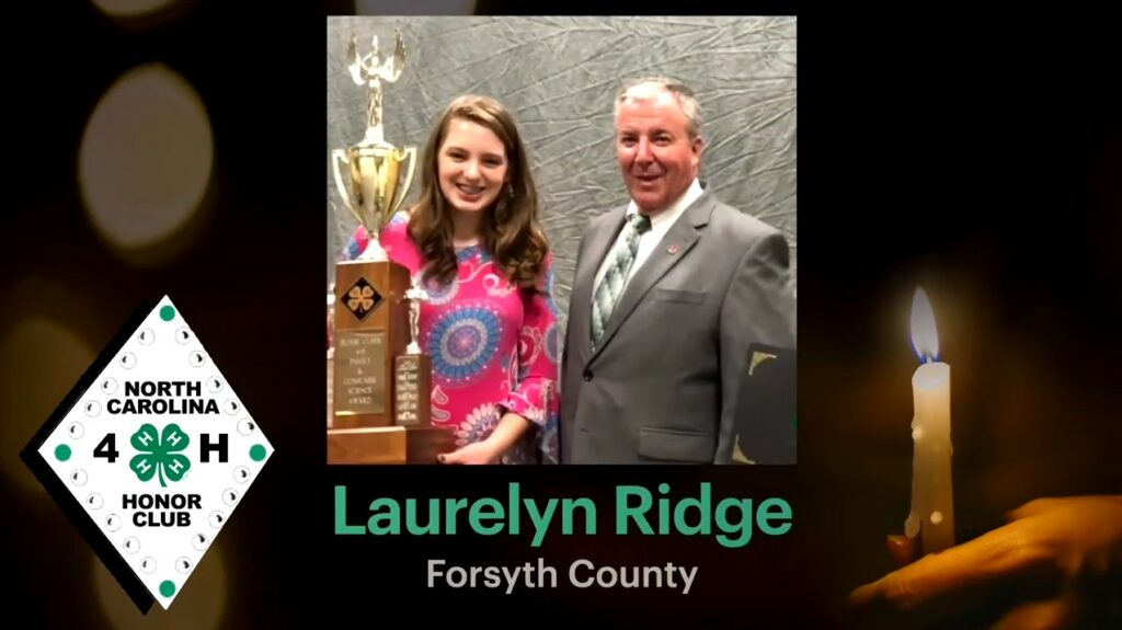 """Screencap of Laurelyn Ridge's induction into the NC 4-H Honor Club. Background is a person holding a candle, the NC 4-H Honor Club logo is to the right, and a photo of Laurelyn Ridge is in the center with her name and """"Forsyth County"""" written below."""
