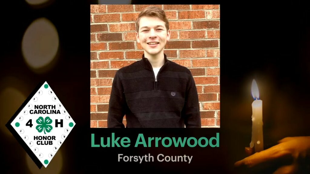 """Screencap of Luke Arrowood's induction into the NC 4-H Honor Club. Background is a person holding a candle, the NC 4-H Honor Club logo is to the right, and a photo of Luke Arrowood is in the center with his name and """"Forsyth County"""" written below."""