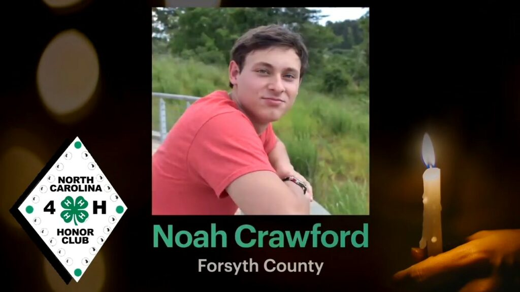 """Screencap of Noah Crawford's induction into the NC 4-H Honor Club. Background is a person holding a candle, the NC 4-H Honor Club logo is to the right, and a photo of Noah Crawford is in the center with his name and """"Forsyth County"""" written below."""
